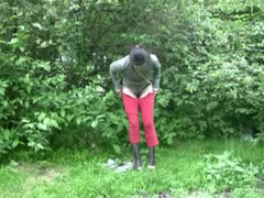 Shy brunette Russian chick in khaki pants pisses in public on spy cam video