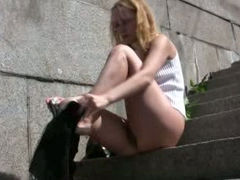 Blonde lady in Russia gets wet in the public place