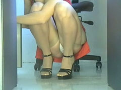 Sexy office colleague in red hot dress caught on voyeur spy cam video