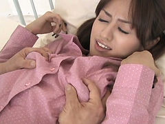 Charming Japanese girl fingered in her bushy pussy