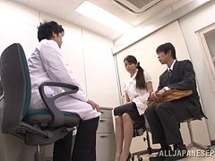 Asian bitch Maki Hokujo gives a blowjob to her hubby in doctor's office